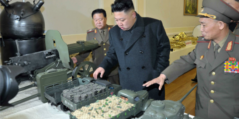Dalek on left, Supreme Leader Kim examines the devastation of the Dalek's deadly shrink ray.