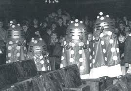 Children in vintage toy Dalek costumes
