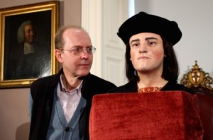 Michael Ibsen, a descendant of of King Richard III, poses for photographers as the face of the king is unveiled to the media at the Society of Antiquaries, London.