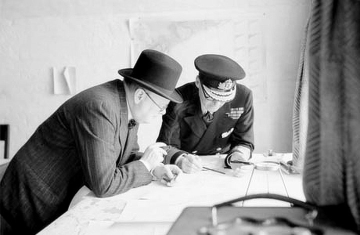 Winston Churchill studies reports of the action that day with Vice Admiral Sir Bertram Ramsay on 28 August 1940.
