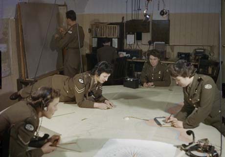 Auxiliary Territorial Services plotters at work in the coastal artillery operations room in the wartime tunnels at Dover Castle in 1942. © Imperial War Museum
