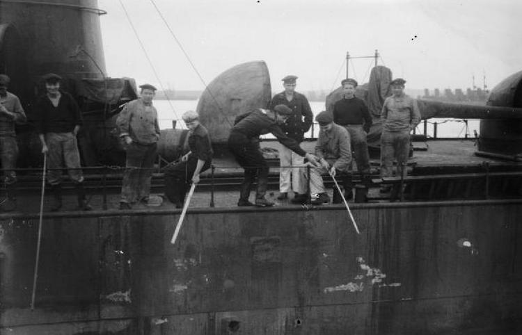 German sailors fishing over the side of a destroyer