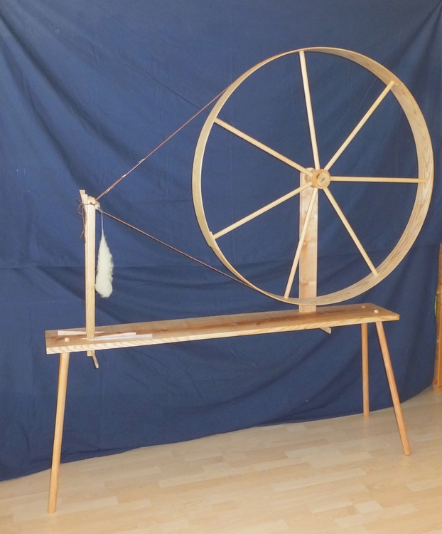 I get to reconstruct tools! Sometimes even really huge ones, like this almost 2 m high spinning wheel. It's late-medieval (about 14th century), made from ash wood, and works very well. (It also saves you a workout at the gym. Spinning with this is work.)