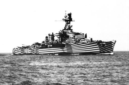 A battle ship in gaily painted stripes.