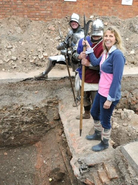 Philippa Langley, a member of the Richard III Society, with medieval re-enactors at the site where Richard III's remains were discovered