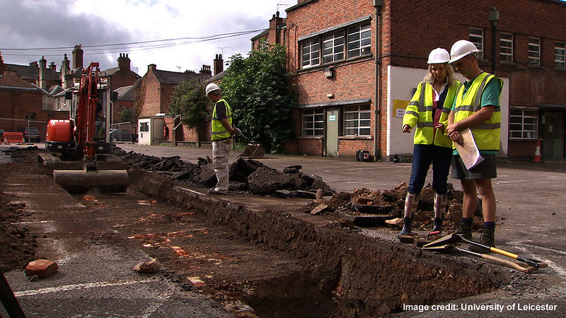 Philippa Langley stands over the trench where King Richard III's remains were discovered