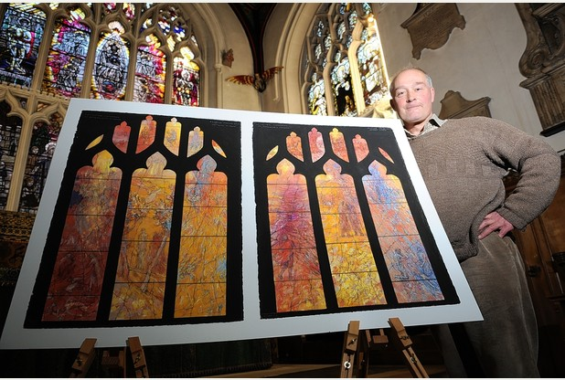 Artist Tom Denny with the stained glass window design revealed today
