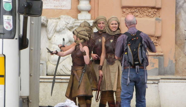 Keisha Castle-Hughes, Jessica Henwick and Rosabell Laurenti Sellers and a stunt-double.