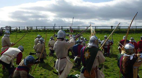 Towton Battlefield Society re-enacting the death of Clifford at Dintingdale