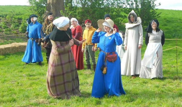 Medieval fashion show showing what was worn as you progressed through the social hierarchy in 1461