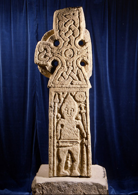 Middleton Cross depicting a Viking warrior surrounded by his weapons